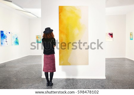 Young woman in modern art gallery Royalty-Free Stock Photo #598478102