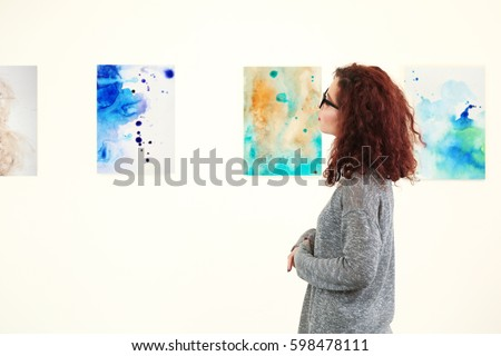 Young woman in modern art gallery Royalty-Free Stock Photo #598478111