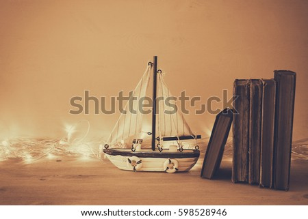 Nautical concept with sea life style objects on wooden table. Sepia style filtered image #598528946