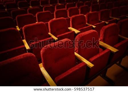 red velvet seats for spectators in the theater or cinema #598537517