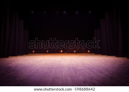 An empty stage of the theater, lit by spotlights before the performance #598688642