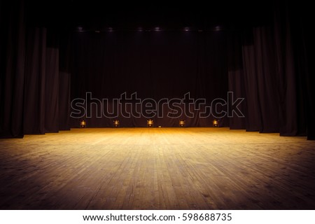 An empty stage of the theater, lit by spotlights before the performance #598688735