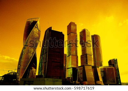 sunset in the city on the background of skyscrapers