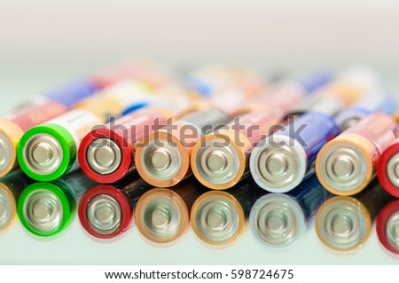 Closeup of pile of used alkaline batteries. Close up colorful rows of AA batteries energy abstract background of colorful batteries. Storage batteries in rows. #598724675