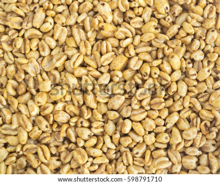 Heap of Puffed Wheat Snack Background. Healthy Cereal Vegetarian or Vegan Food #598791710