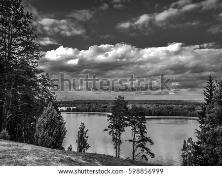 Picturesque view on the lake and forest at evening time just before the sunset. #598856999