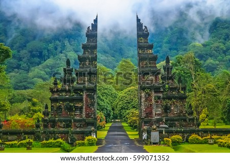 Gates to one of the Hindu temples in Bali in Indonesia Royalty-Free Stock Photo #599071352