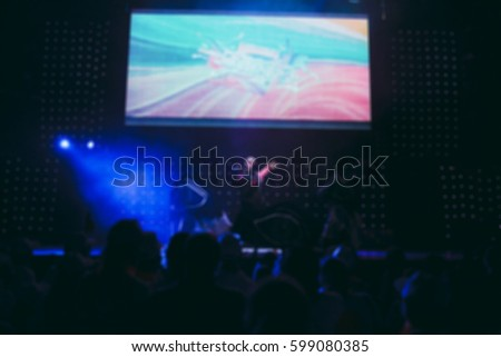 Blurred background : Bokeh lighting in concert with audience, Music showbiz concept #599080385