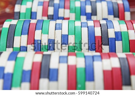 Casino poker money chips texture. Stack of poker chips as background.  #599140724