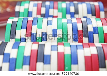 Casino poker money chips texture. Stack of poker chips as background.  #599140736