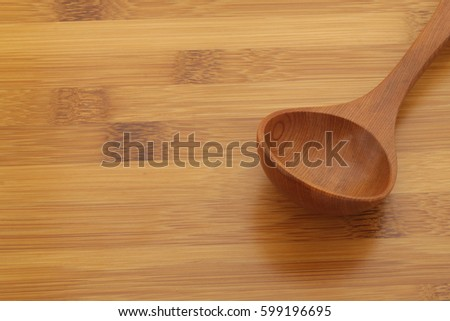 Wooden spoon on bamboo board background #599196695