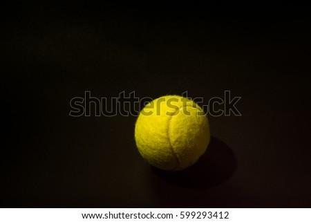 Tennis in black background. #599293412