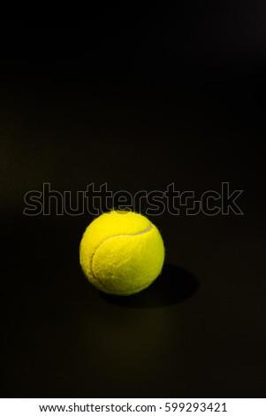 Vertical shooting Tennis in black background. #599293421