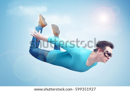 Crazy man in goggles is flying in the sky. Jumper concept #599351927