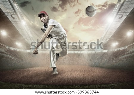 Baseball players in action on the stadium. #599363744