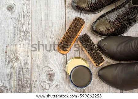 Shoes and care products for footwear on a gray wooden floor. #599662253