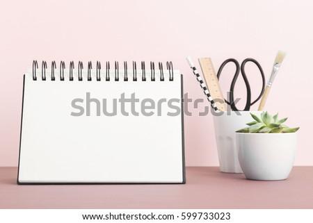 Calendar mock up on pink shelf.