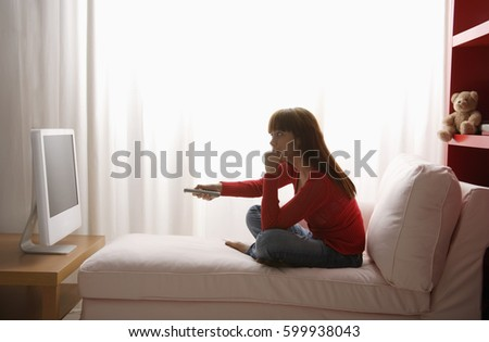 Asian girl watching TV in her bedroom #599938043