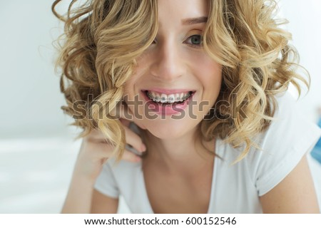 Young woman in braces #600152546
