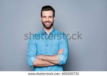 Portrait of happy fashionable handsome man in jeans shirt  crossing hands and look at camera #600200732