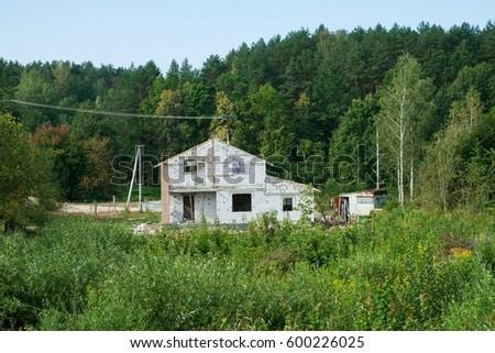 IZOBLOK BUILDING SYSTEM. Construction of the Unfinished white brick house #600226025