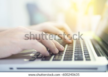 Close-up shot of user the laptop keyboard #600240635