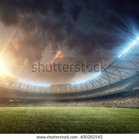 soccer stadium with tribunes and illumination #600282542