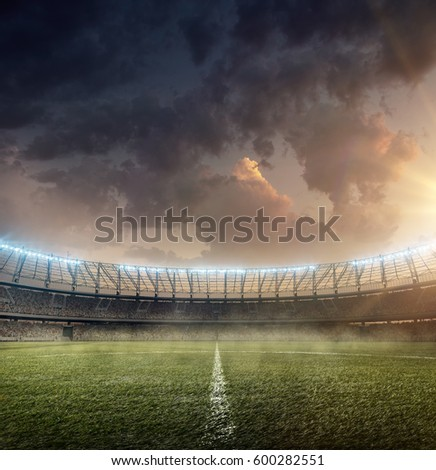 soccer stadium with grass Royalty-Free Stock Photo #600282551