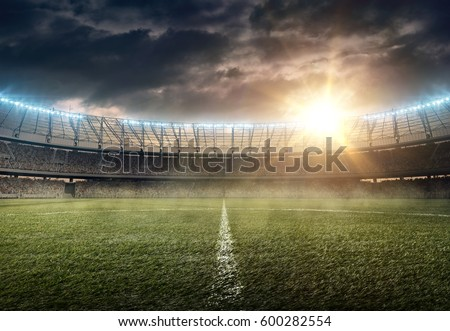 soccer stadium on a sunset Royalty-Free Stock Photo #600282554