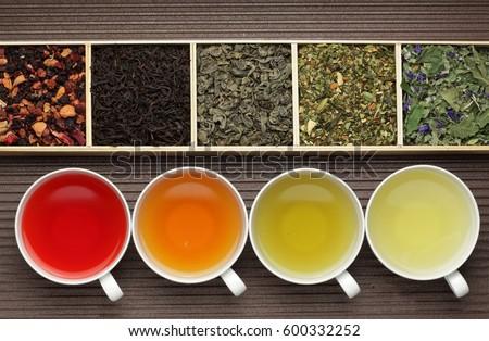Black tea, green tea, fruit tea cups / tea assortment in boxes Royalty-Free Stock Photo #600332252