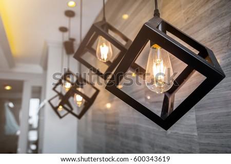 modern pendant light with vintage light bulb #600343619