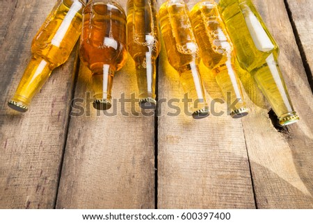 Beer bottles on a wooden table . #600397400