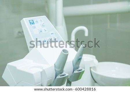 Equipment and dental instruments in dentist's office. modern Tools close-up. Dentistry.  Different dental instruments and tools in a dentists office. #600428816
