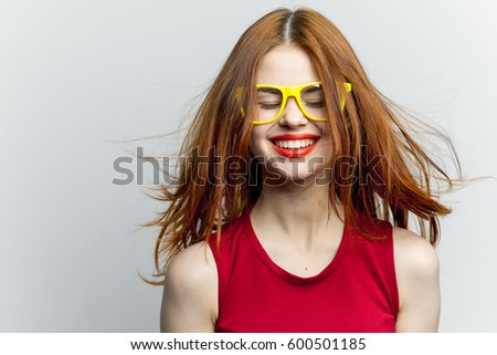 Funny pretty woman smiles into the camera #600501185