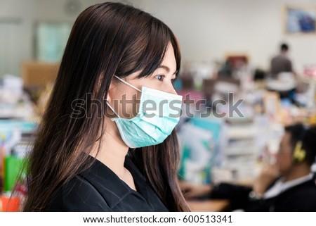Asian woman wear face mask in office #600513341