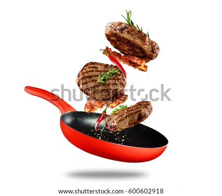 Beef milled meat flying from a pan, isolated on white background Royalty-Free Stock Photo #600602918