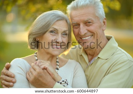 Happy elderly couple embracing #600644897