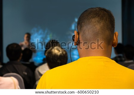 The Male Audience at International Business Meeting or Seminar wearing headphone for online interpreter or Translation as part of Interpretation System Royalty-Free Stock Photo #600650210