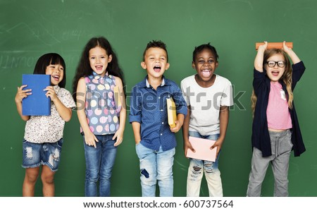 Group of school kids reading for education Royalty-Free Stock Photo #600737564