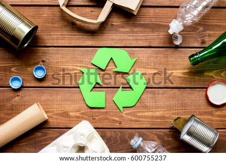 Eco concept with recycling symbol on table background top view Royalty-Free Stock Photo #600755237