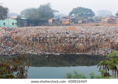 Rubbish pollution with plastic and other packaging stuffs in the nature, Thaung Yin river, Myawaddy, Myanmar #600826469