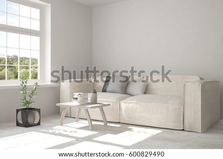 White room with sofa and green landscape in window. Scandinavian interior design. 3D illustration #600829490