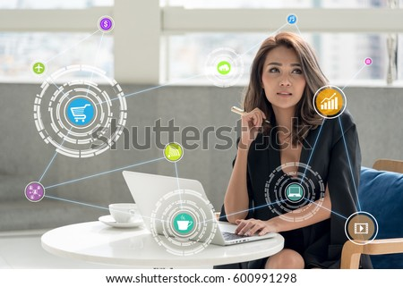 young woman using tablet control the business in daily life , internet of things(IOTs) concept #600991298