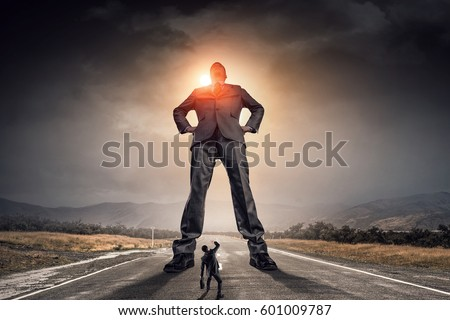 He is big boss and has power . Mixed media Royalty-Free Stock Photo #601009787
