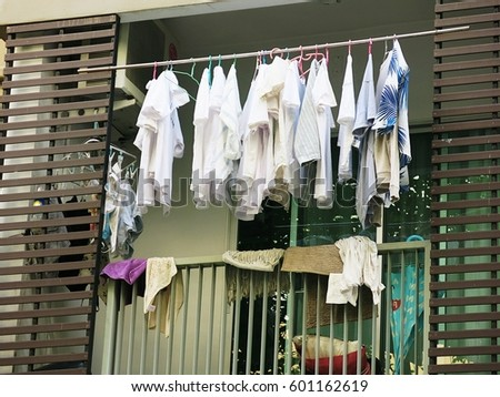 Drying clothes on the balcony of the condo on the day without the sun from the sun #601162619
