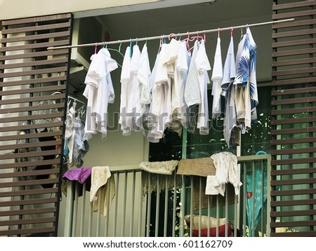 Drying clothes on the balcony of the condo on the day without the sun from the sun #601162709