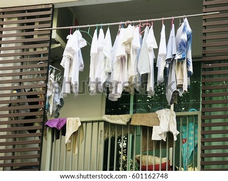 Drying clothes on the balcony of the condo on the day without the sun from the sun #601162748