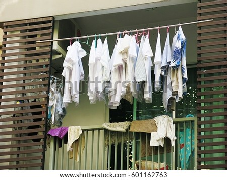 Drying clothes on the balcony of the condo on the day without the sun from the sun #601162763