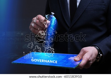 Business, Technology, Internet and network concept. Young businessman working on a virtual screen of the future and sees the inscription: Governance Royalty-Free Stock Photo #601183910