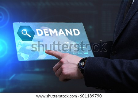 Business, Technology, Internet and network concept. Young businessman working on a virtual screen of the future and sees the inscription: Demand #601189790
